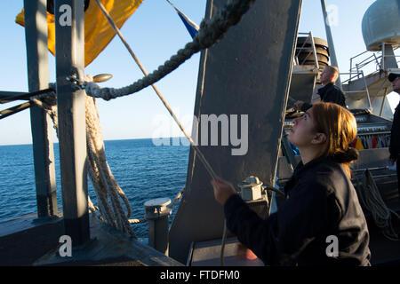 150909-N-AX546-009 BLACK SEA (Sept. 9, 2015) Quartermaster 3rd Class Denise Almaraz, from San Antonio, Texas, raises - Stock Photo