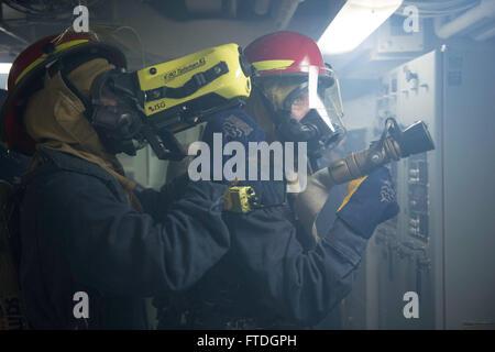 131008-N-UD469-180: MEDITERRANEAN SEA (Oct. 8, 2013) - Damage Controlman Fireman Jonathan Church mans the fire hose, - Stock Photo