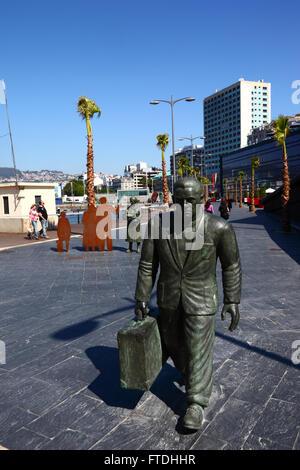 Statue of man preparing to board ship in port, Vigo, Galicia, Spain - Stock Photo