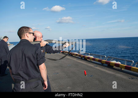 151031-N-AX638-398 MEDITERRANEAN SEA (Oct. 31, 2015) Chief Warrant Officer 2 Mike Hayden, from Weymouth, Massachusetts, Gunner of the amphibious assault ship USS Kearsarge (LHD 3), fires an M-500 shotgun while Gunner's Mate 2nd Class Kyle Orr, from Cedar Rapids, Iowa, acts as line coach during a small arms live-fire exercise on the flight deck aboard Kearsarge (LHD 3), Oct. 31, 2015. Kearsarge, deployed as part of the Kearsarge Amphibious Ready Group, is conducting naval operations in the U.S. 6th Fleet area of operations in support of U.S. national security interests in Europe. (U.S. Navy Pho