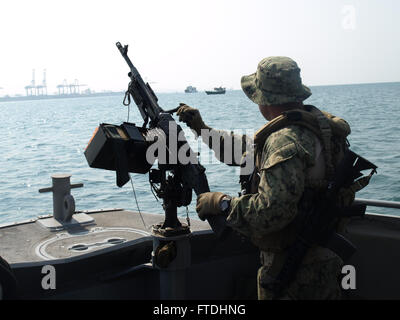 151102-N-ZZ999-300 REPUBLIC OF DJIBOUTI (Nov. 2, 2015) A Sailor assigned to Coastal Riverine Squadron 10 provides - Stock Photo