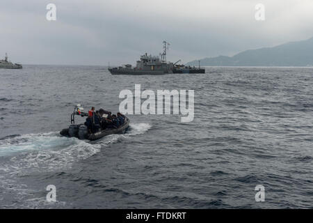 160202-N-TC720-075 PORT VICTORIA, Seychelles (Feb.2, 2016) -Maritime forces from Seychelles pilot a rigid hull inflatable - Stock Photo