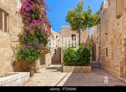 Narrow cobbled street among typical houses of Jewish Quarter in Old City of Jerusalem, Israel. - Stock Photo