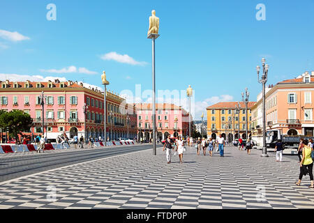 People walking on Place Massena in Nice, France. - Stock Photo