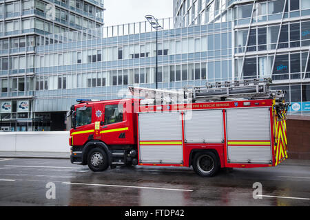 Merseyside Fire & Rescue appliance, fire, truck, emergency, vehicle, rescue, car, firefighter, safety, engine, red, - Stock Photo