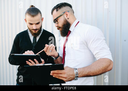 Two businessmen discussing something - Stock Photo