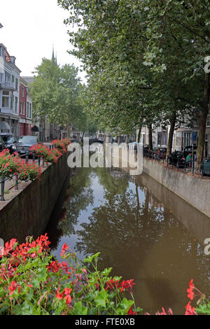A canal in Gouda, South Holland, Netherlands. - Stock Photo