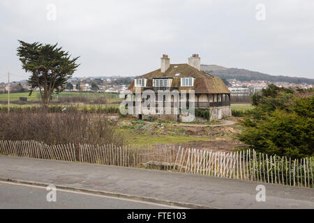 Odstone is a property in Rhos on Sea with legendary links to Prince Madoc who reputedly set sail from here in 1170 - Stock Photo