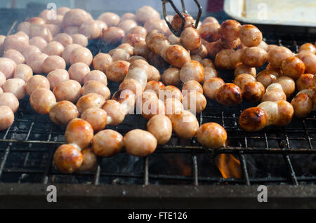 Thai Style Grilled Sausage on Stove - Stock Photo