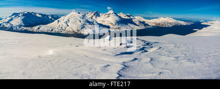 Panoramic view from Rodtinden with views towards Store Blamann and the open ocean, Kvaloya Troms, Northern Norway - Stock Photo