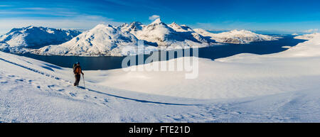 Panoramic view ski touring on Rodtinden with views towards Store Blamann and the open ocean, Kvaloya Troms, Northern - Stock Photo