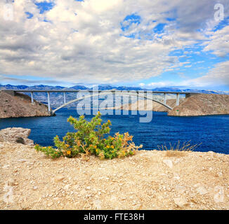 Pag bridge in Croatia. The bridge connecting the mainland to island of Pag and terminating in Zigljen ferry port. - Stock Photo