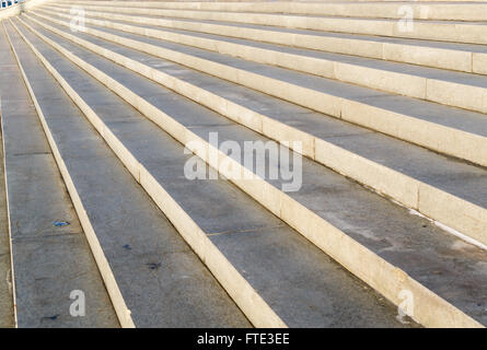 Lines of concrete urban steps create abstract diagonal patterns in a late winter sun. Nobody present in the image. - Stock Photo