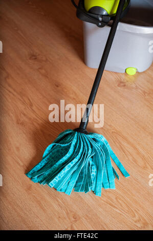 Mop with a bucket - Stock Photo
