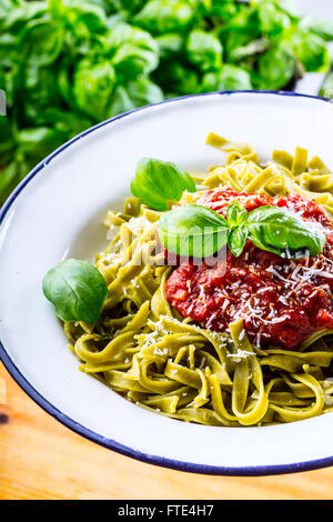 Pasta. Italian and Mediterranean cuisine. Pasta Fettuccine with tomato sauce basil leaves garlic and parmesan cheese. - Stock Photo