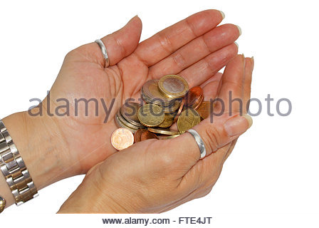 Two woman hands holding some euro coins - Stock Photo