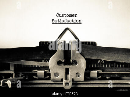 Customers satisfaction and customer service motto on a vintage typewriter - Stock Photo
