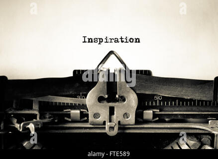 Inspiration message typed on vintage typewriter - Stock Photo