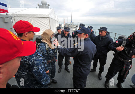131112-N-PE825-075: BATUMI, Georgia (Nov. 12, 2013) – Georgian coast guardsmen get hands on damage control training - Stock Photo