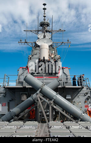 140301-N-WD757-150 MEDITERRANEAN SEA (MAR. 1, 2014) – Sailors wipe away sea salt from a close-in weapons system - Stock Photo