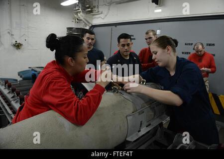140623-N-MW280-147 MEDITERRANEAN SEA (June 23, 2014) – Aviation Ordnanceman Airman Alyssa Nester (right), from Shreveport, - Stock Photo