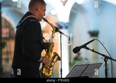 BATUMI, Georgia (Oct. 15, 2014) – A member of the U.S. Naval Forces Europe (NAVEUR) band plays the saxophone at - Stock Photo