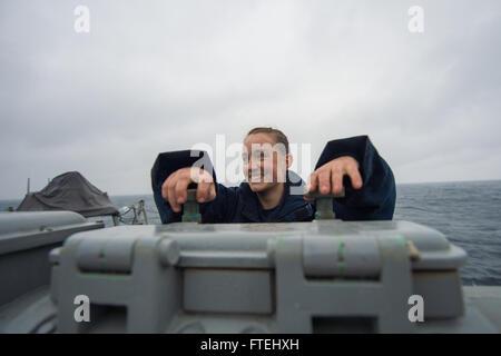 BLACK SEA (Oct. 29, 2014) – Gunner's Mate 3rd Class Rachael Beglan conducts periodic scheduled maintenance on a - Stock Photo