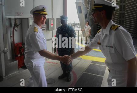 SEKONDI, Ghana (Feb. 24, 2015) U.S. 6th Fleet Vice Commander, Rear Adm. Tom Reck, left, shakes hands with the Military - Stock Photo