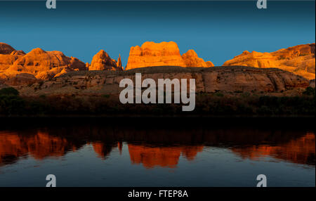 A panoramic view of the Colorado River and reflections at sunset, near Moab Utah - Stock Photo