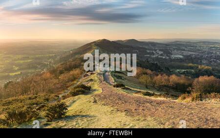 The winter sun rises over the Malvern hills. - Stock Photo