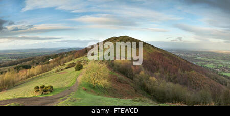 Black Hill, part of the Malvern Hills, catches the last of the sunlight as the sun sets over Worcestershire. - Stock Photo