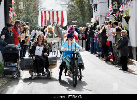 Bolney, Sussex, UK. 28th March, 2016.  Competitors take part in the Bolney Pram Races held every year on Easter - Stock Photo