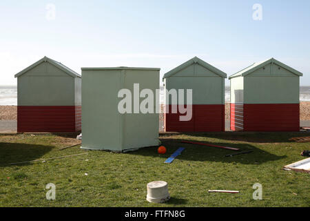 Brighton, UK. 28th Mar, 2016. An unturned beach hut lies on its back in Hove after winds and rain brought by Storm - Stock Photo