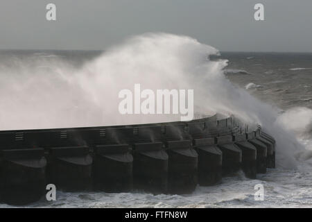 Brighton, UK. 28th Mar, 2016. Waves crash over the Brighton Marina wall as Storm Katie batters the coast at Brighton, - Stock Photo