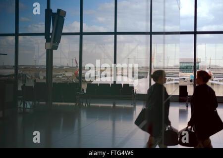 Passenger at London Heathrow Terminal 5 - Stock Photo