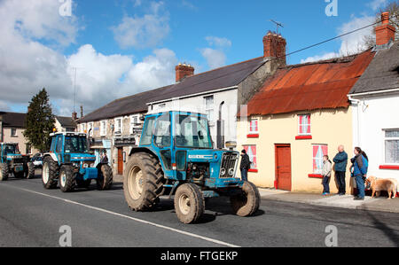Tractors travel through Carrickmacross on Easter Monday 2016 - Stock Photo
