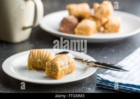 sweet baklava dessert on plate - Stock Photo