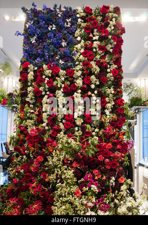 Red white and blue flowers with the united kingdom national flag patrioti macys annual flower show the american flag composed of roses and other red white mightylinksfo