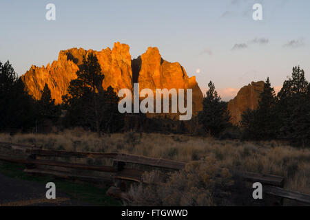 The Moon Sets as Sun Rises on Smith Rock Oregon - Stock Photo