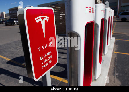 Tesla Motors recharging units at King's Cross outlet mall in in Kingston, Ont., on Tuesday Nov. 3, 2015. - Stock Photo