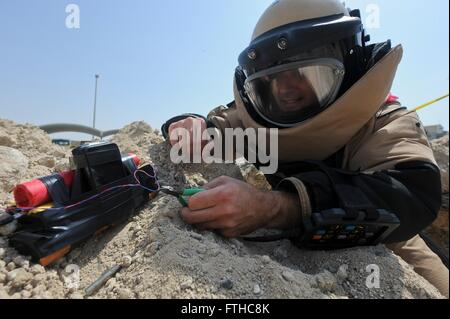 U.S Air Force Staff Sgt. Andrew Roberts an explosive ordnance disposal technician disables a training improvised - Stock Photo