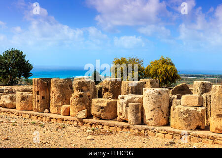 The ancient stones and columns are the preserved parts of the Aphrodite sanctuary in Kouklia, Cyprus. - Stock Photo