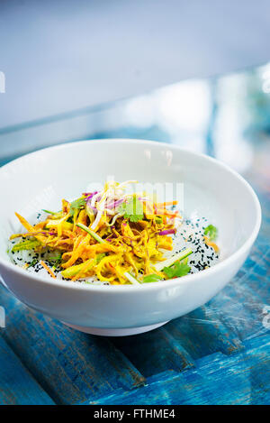 curry sauce vegetable salad with noodles and sesame modern asian fusion dish - Stock Photo