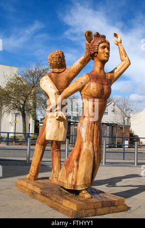Wooden sculpture of Lord Byron and his wife Annabella Milbanke  outside the Byron Place shopping centre, Seaham, - Stock Photo