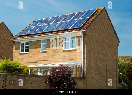 photovoltaic solar panels on house in the UK - Stock Photo