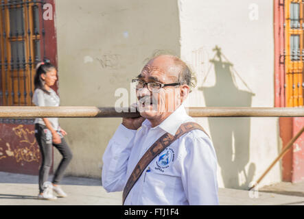 A man going to the Holy Friday procession in Oaxaca. - Stock Photo