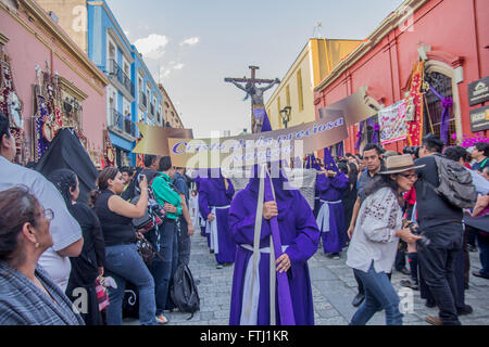 People at the Holy Friday procession in Oaxaca, Mexico. The placard says 'Christ of the precious blood.' - Stock Photo