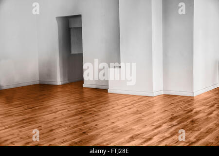 View of empty unfurnished room with parquet and white walls - Stock Photo
