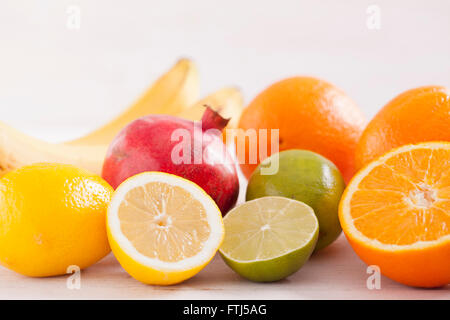 Healthy and fresh mixed juice from fruits on white wooden table - Stock Photo
