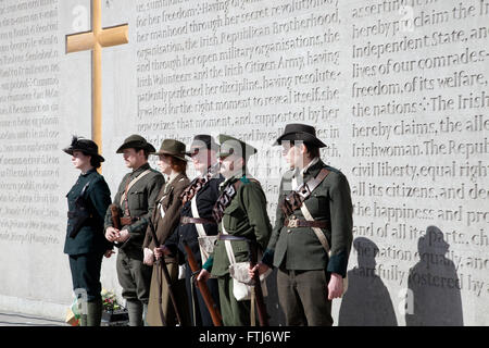 Actors portraying the 1916 Easter Rising leaders at Arbor Hill Cemetery in Dublin city, Ireland. - Stock Photo